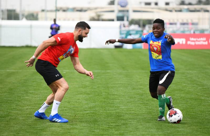Abu Dhabi, United Arab Emirates - Finn Balor, an Irish professional wrestler signed to WWE plays for the second match of the Unified Sports Experience at Zayed Sports City. Khushnum Bhandari for The National