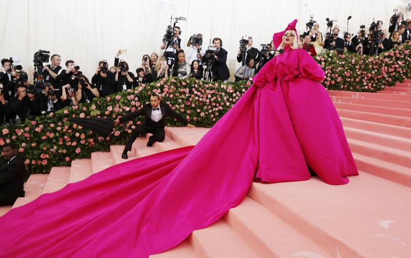 epa08431348 Lady Gaga wears a spectacular pink evening gown as she arrives for the 2019 Met Gala in New York, USA, 06 May 2019 (reissued 19 May 2020). Pink became fashionable as a luxurious color worn by both sexes in the mid 1700s. By the time men moved to darker hues, women adopted pink and it became the girls' color. In the 1960s high fashion and celebrities embraced pink. A significant change took place when the color became a symbol for women's and LGBTQ rights in the 1970s and, from 1990 on, also the symbolic color for the struggle against breast cancer. Subsequently, pink is now recognized as a color of protest, femininity, joy, energy and affirmation.  EPA-EFE/JUSTIN LANE  ATTENTION: This Image is part of a PHOTO SET