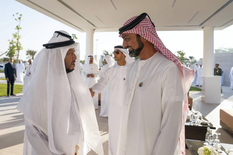 ABU DHABI, UNITED ARAB EMIRATES - November 30, 2017: HH Sheikh Sultan bin Zayed Al Nahyan, UAE President's Representative (L) and HH Sheikh Ammar bin Humaid Al Nuaimi, Crown Prince of Ajman (R), attend a Commemoration Day ceremony at Wahat Al Karama, a memorial dedicated to the memory of UAE's National Heroes in honour of their sacrifice and in recognition of their heroism. ( Mohamed Al Hammadi / Crown Prince Court - Abu Dhabi ) ---