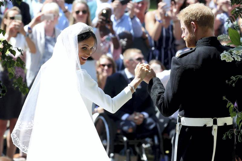 WINDSOR, UNITED KINGDOM - MAY 19:  Prince Harry and Meghan Markle leave St George's Chapel in Windsor Castle after their wedding  on May 19, 2018 in Windsor, England. (Photo by Danny Lawson - WPA Pool/Getty Images)