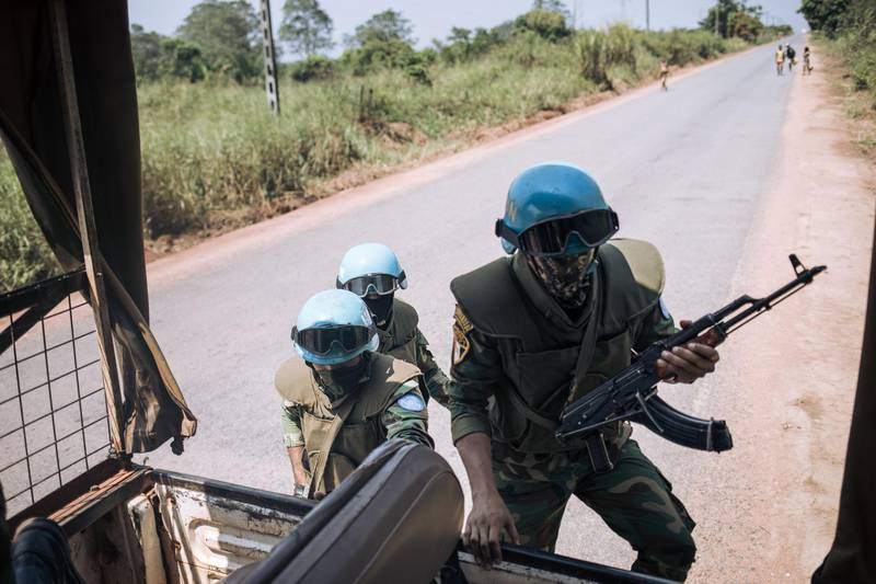"""Egyptian commandos of the United Nations Multidimensional Integrated Stabilization Mission in the Central African Republic (MINUSCA) patrol on the outskirts of Bangui, the capital of the Central African Republic, on December 25, 2020. Two days before the presidential and legislative elections, the security situation in the country is very tense, with rebels less than 100km from the capital. The coalition of armed groups that has been conducting a week-long offensive against several towns in the country decided to break their truce today and """"resume its relentless march to its final objective"""", according to a statement confirmed to AFP by two major rebel groups. / AFP / ALEXIS HUGUET"""