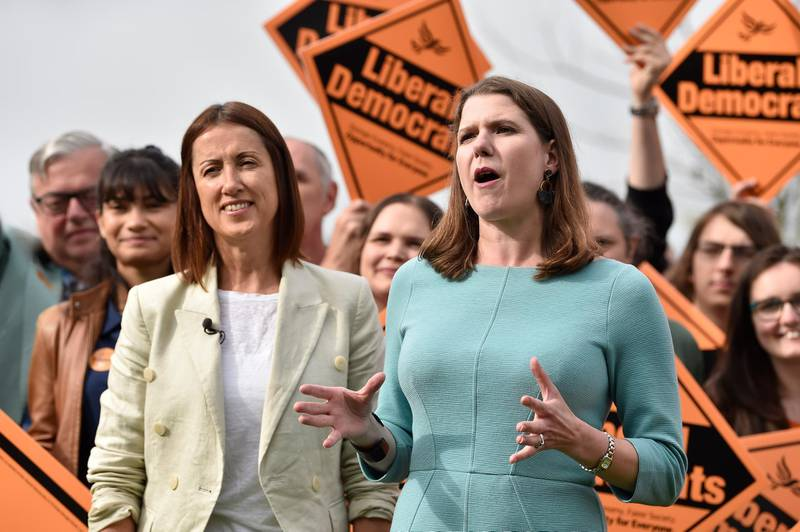 BRECON, UNITED KINGDOM - AUGUST 02: By-election victor and Welsh Lib Dem leader Jane Dodds MP (L) poses with Lib Dem leader Jo Swinson MP at a photocall to celebrate the victory in the Garden of the Castle Hotel, Castle Square on August 2, 2019 in Brecon , Wales. The Liberal Democrat, Jane Dodds overturned an 8,038 majority beating Conservative Chris Davies by 1,425 votes, leaving the new PM Boris Johnson with a Commons working majority of just one.  The by-election was called after Chris Davies, who had held the Brecon and Radnorshire seat for the Conservative Party since the 2015 general election, was unseated by a recall petition.  (Photo by Matthew Horwood/Getty Images)