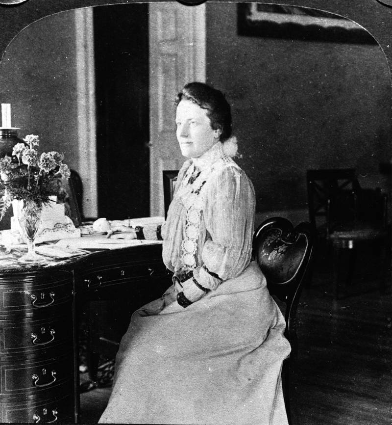 U.S. First Lady Edith Roosevelt (1861 - 1948) sits at her desk in the second floor private library of the White House, 1903. She was the second wife of president Theodore Roosevelt. (Photo by Hulton Archive/Getty Images)