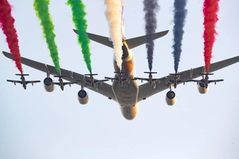 ABU DHABI, UNITED ARAB EMIRATES - March 14, 2019: Etihad Airways and the UAE Forsan Aerobatics team perform a flyby during the opening ceremony of the Special Olympics World Games Abu Dhabi 2019, at Zayed Sports City.  ( Ryan Carter for the Ministry of Presidential Affairs ) ---