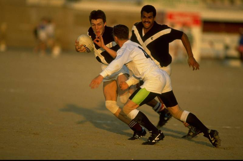1990:  Michael Dodds (left) of Saltires is charged down during the Dubai Sevens match against Hong Kong in Dubai, United Arab Emirates. \ Mandatory Credit: Russell  Cheyne/Allsport
