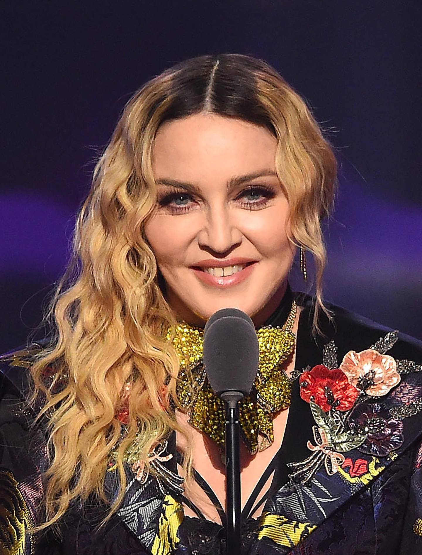 NEW YORK, NY - DECEMBER 09: Madonna speaks on stage at the Billboard Women in Music 2016 event on December 9, 2016 in New York City.   Nicholas Hunt/Getty Images for Billboard Magazine/AFP