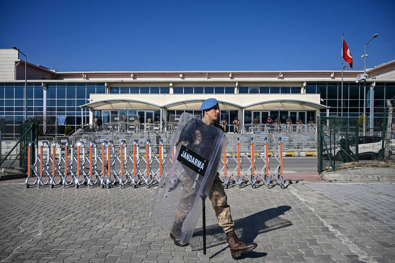 Turkish soldiers stand guard in front of the Silivri Prison and Courthouse complex in Silivri, near Istanbul on February 18, 2020 during the trial of Gezi protests and civil society figure Osman Kavala, along with 15 other people, charged with seeking to overthrow the government. (Photo by Ozan KOSE / AFP)