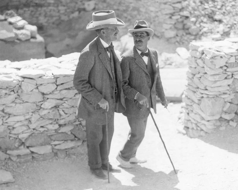 English Egyptologist Howard Carter (1874 - 1939, right) walks with the patron of his research, archaeologist and 5th Earl, Lord Carnarvon George Herbert (1866 - 1923), at the Valley of the Kings excavation site, Egypt. That year the pair discovered the tomb of King Tutankhamen.  (Photo by Hulton Archive/Getty Images)