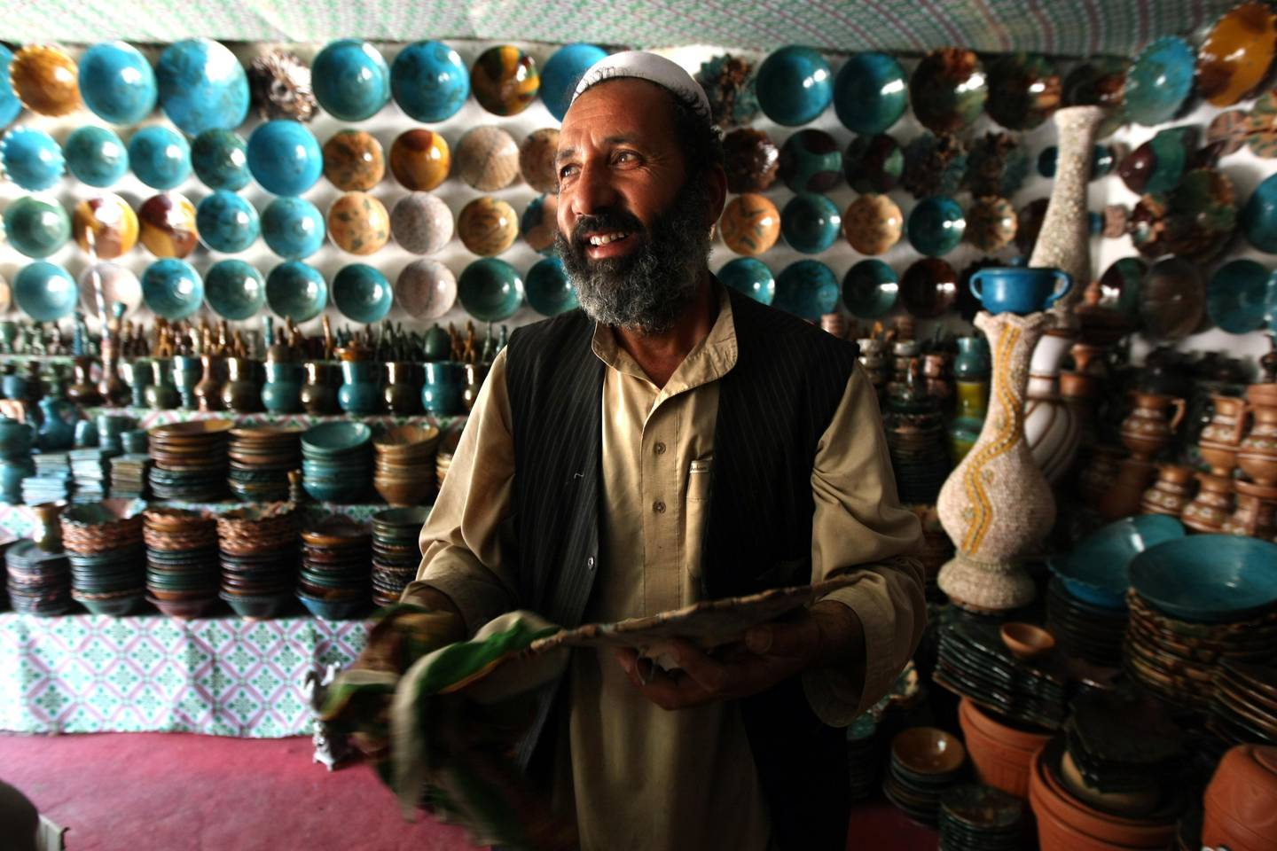 June 6, 2008 / Istalif /  Malik Mohammad owns this pottery shop in Istalif Afghanistan. During the Telaban's rule pottery shops in Istalif where destroyed, but with the help of the Turquoise Mountain Foundation the shops have returned June 6, 2008. (Sammy Dallal / The National) *** Local Caption ***  sd-afghanday4-3.jpg sd-afghanday4-3.jpgrv20afghanarts8.jpg