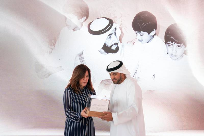 ABU DHABI, UNITED ARAB EMIRATES - March 13, 2019: HE Falah Mohamed Al Ahbabi, Chairman of the Department of Urban Planning and Municipalities, and Abu Dhabi Executive Council Member (R) and Karen Pence, Second Lady of the United States (L), exchange gifts during a reception for the Special Olympics World Games Abu Dhabi 2019, at the Founders Memorial.  ( Mohammed Al Hammadi / Ministry of Presidential Affairs )?