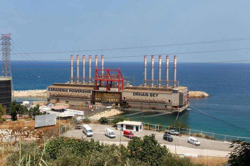 FILE PHOTO: Karadeniz Powership Orhan Bey, an electricity-generating ship from Turkey, docked at the port of Jiyeh, south of Beirut, Lebanon August 10, 2017. REUTERS/Aziz Taher/File Photo