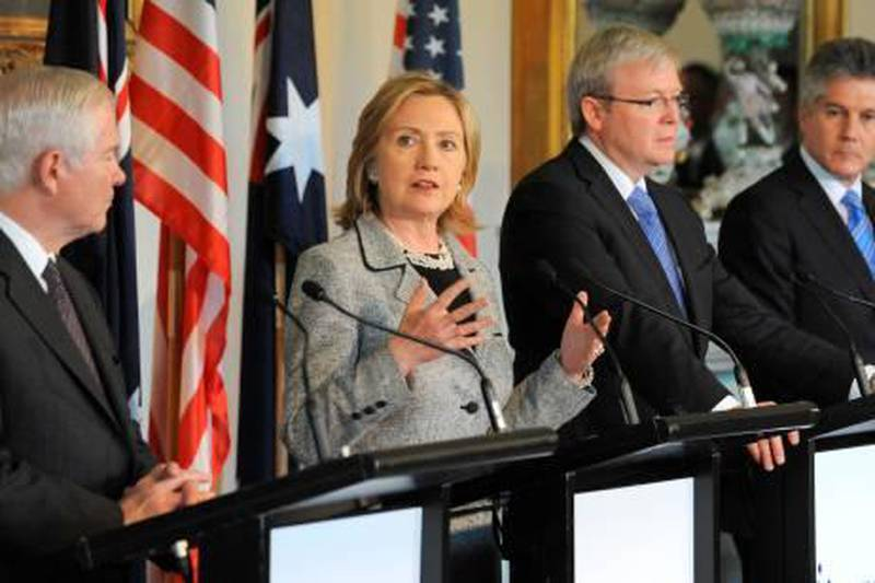 """US Secretary of State Hillary Clinton (2L) speaks at a joint press conference withd US Secretary of Defense Robert Gates (L) and their Australian counterparts, Foreign Minister Kevin Rudd (2R) and Defence Minister Stephen Smith (R) after the annual AUSMIN defence and security talks in Melbourne on November 8, 2010. The United States urged China to be a """"responsible player"""" as its global influence grows and stressed its commitment to Asia after security talks with Australia during a regional diplomatic push. Secretary of State Hillary Clinton made the comment after meeting Australian officials alongside US Defence Secretary Robert Gates, in talks which produced an agreement to cooperate on security surveillance in outer space. AFP PHOTO/William WEST  *** Local Caption ***  603920-01-08.jpg"""