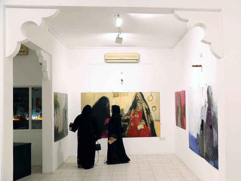 Dubai, March 20, 2018: Visitors take a look at the arts displayed at the Fatma Lootah Gallery during the Sikka Art fair at Al Fahidi Historical District in Dubai. Satish Kumar for the National