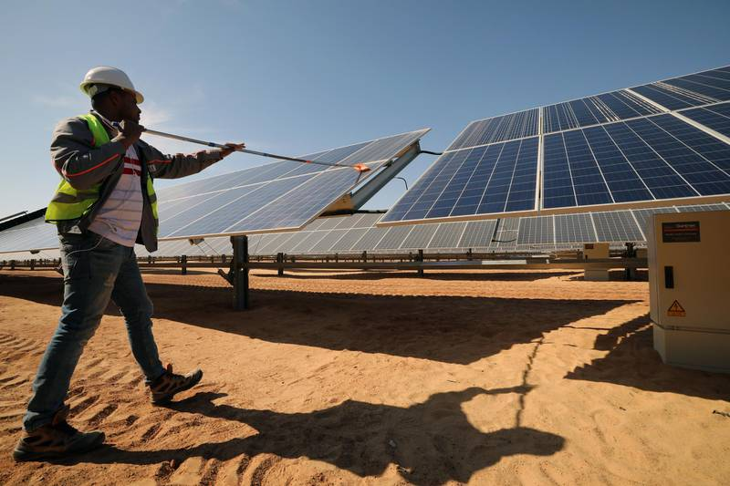 epa08150115 A man cleans the photovoltaic solar panels at the Benban Solar Park, the world's largest solar power plant in the world, in Aswan, Egypt, 18 January 2020 (issued 22 January 2020). The Benban Solar park has 32 power plants with a capacity of 1465 megawatts. Egypt is aiming at satisfying 45 percent of its energy needs through renewable energy by the year 2035.  EPA/KHALED ELFIQI