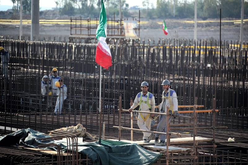 A picture taken on November 10, 2019, shows workers on a construction site in Iran's Bushehr nuclear power plant during an official ceremony to kick-start works for a second reactor at the facility. - Bushehr is Iran's only nuclear power station and is currently running on imported fuel from Russia that is closely monitored by the UN's International Atomic Energy Agency. (Photo by ATTA KENARE / AFP)