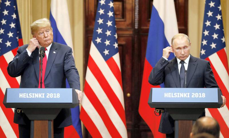 epa08939637 (FILE) US President Donald J. Trump (L) and Russian President Vladimir Putin (R) adjust their earpiece plugs during a joint press conference following their summit talks at the Presidential Palace in Helsinki, Finland, 16 July 2018. The presidency of Donald Trump, which records two presidential impeachments, will end at noon on 20 January 2021.  EPA-EFE/ANATOLY MALTSEV *** Local Caption *** 56621650