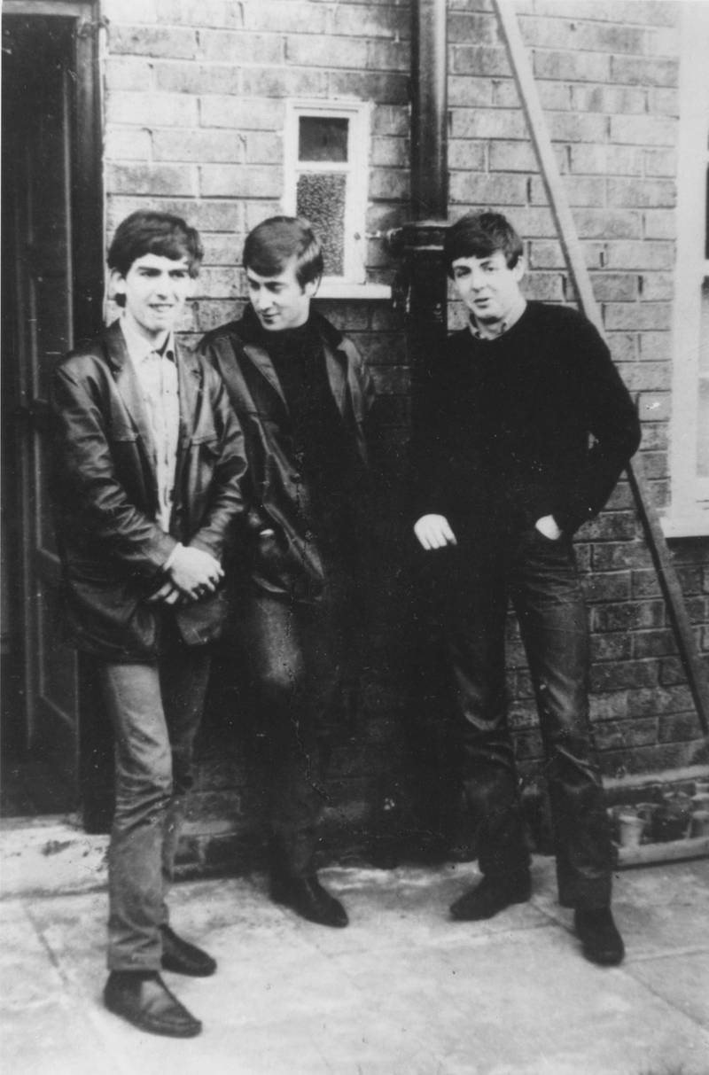 circa 1960:  Liverpudlian skiffle beat band The Beatles standing outside Paul's Liverpool home (left to right) George Harrison (1943 - 2001), John Lennon (1940 - 1980), Paul McCartney. Ringo Starr was not to join the band for another two years.  (Photo by Keystone/Hulton Archive/Getty Images)