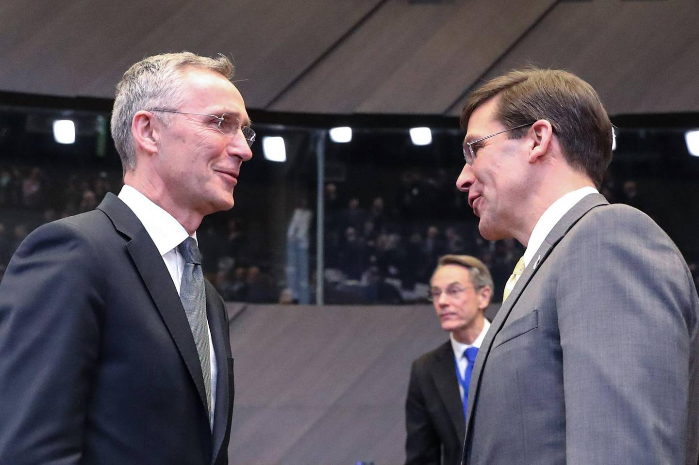 NATO Secretary General Jens Stoltenberg (L), speaks with U.S. Secretary for Defense Mark Esper during a NATO defence minister's meeting in Brussels on February 13, 2020, to address key issues including the Alliance's training mission in Iraq and the fight against international terrorism.  Ministers will also discuss NATO's presence in Afghanistan, the challenges posed by Russia's missile systems and NATO-EU cooperation. / AFP / Aris Oikonomou