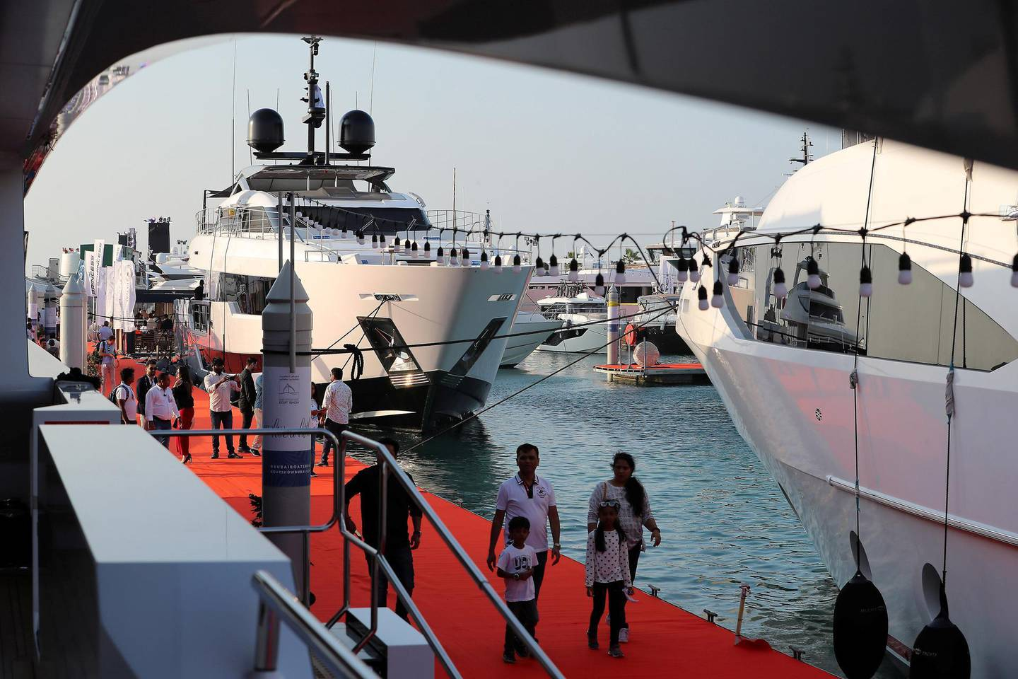 DUBAI , UNITED ARAB EMIRATES , February 26 – 2019 :- Visitors looking boats and yachts at the Dubai International Boat Show held in Dubai. ( Pawan Singh / The National ) For News/Instagram/Big Picture. Story by Nick Webster