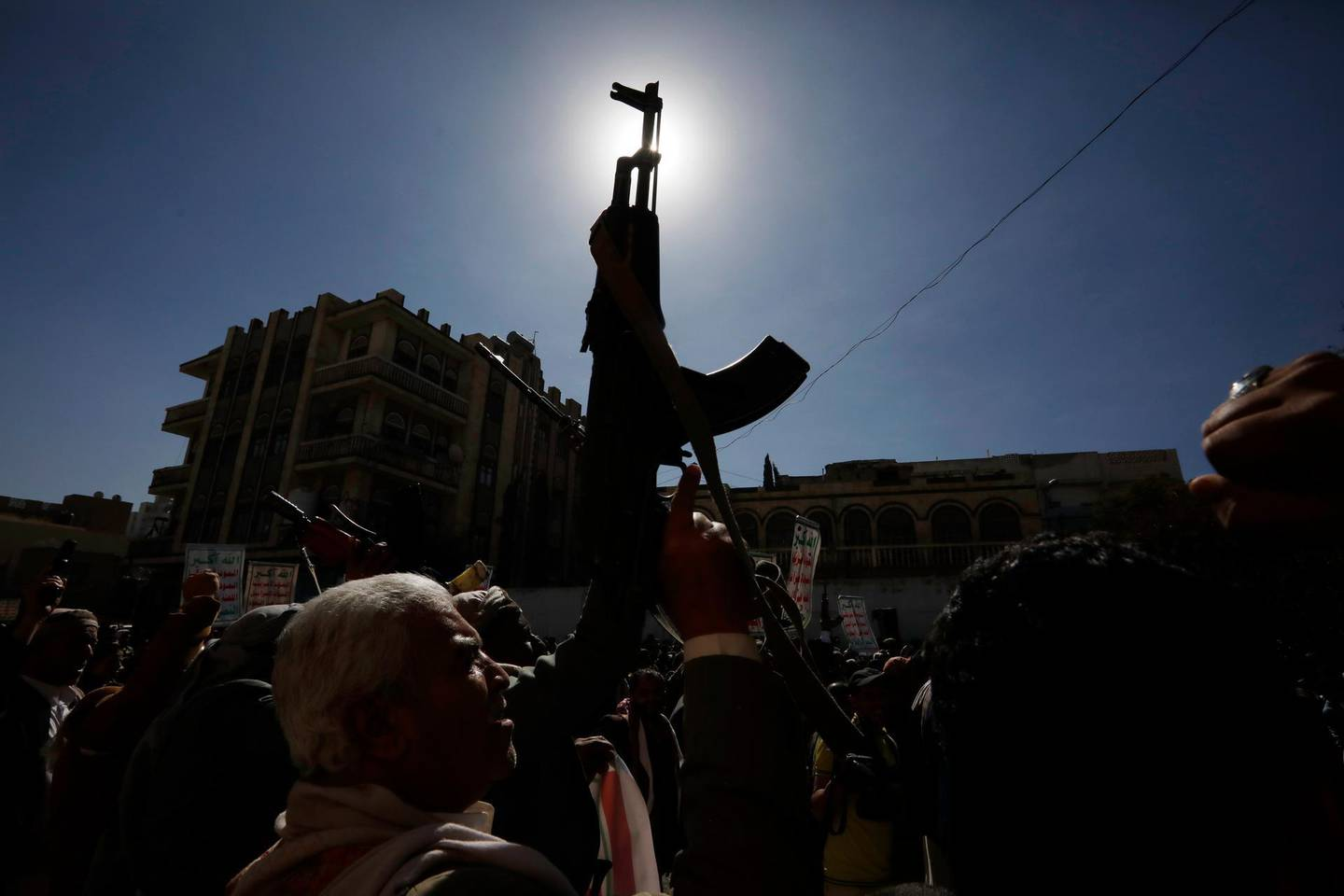 epa08950869 Yemenis hold up guns during an anti-US protest in Sana'a, Yemen, 20 January 2021. According to reports, US Secretary of State Tony Blinken has pledged to immediately review the US terrorist designation of Yemen's Houthi movement a day after Donald Trump's government designated it as a Foreign Terrorist Organization (FTO).  EPA/YAHYA ARHAB