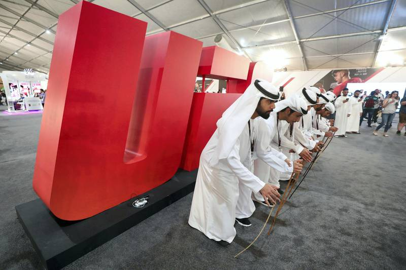Abu Dhabi, United Arab Emirates - September 06, 2019: Emirati dancers at the UFC fan zone. Friday the 6th of September 2019. Yes Island, Abu Dhabi. Chris Whiteoak / The National