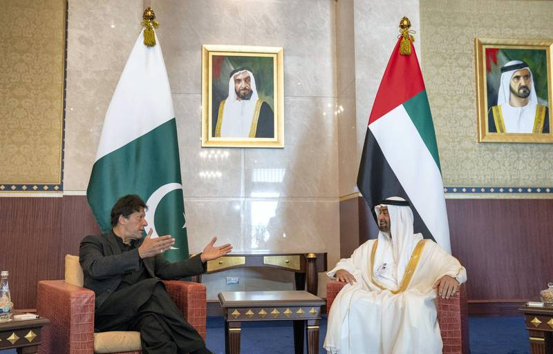 ABU DHABI, UNITED ARAB EMIRATES - February 10, 2019: HH Sheikh Mohamed bin Zayed Al Nahyan Crown Prince of Abu Dhabi Deputy Supreme Commander of the UAE Armed Forces (R), receives HE Imran Khan Prime Minister of Pakistan (L), during a reception at the Presidential Airport.   ( Mohamed Al Hammadi / Ministry of Presidential Affairs ) ---