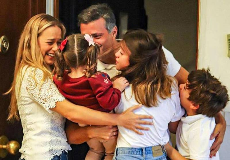 """Handout picture posted on October 25, 2020 on the Instagram account of @leopoldolopezoficial, of Venezuelan high-profile opposition politician Leopoldo Lopez greeting his wife Lilian Tintori (L) and their sons in Madrid. Venezuelan opposition figure Leopoldo Lopez, who had been sheltering at the Spanish ambassador's residence in Caracas for 18 months, arrived Sunday in Madrid after fleeing his home country, his father told AFP.  - RESTRICTED TO EDITORIAL USE - MANDATORY CREDIT """"AFP PHOTO / Instagram account @leopoldolopezoficial / handout"""" - NO MARKETING - NO ADVERTISING CAMPAIGNS - DISTRIBUTED AS A SERVICE TO CLIENTS   / AFP / Instagram account @leopoldolopezoficial / - / RESTRICTED TO EDITORIAL USE - MANDATORY CREDIT """"AFP PHOTO / Instagram account @leopoldolopezoficial / handout"""" - NO MARKETING - NO ADVERTISING CAMPAIGNS - DISTRIBUTED AS A SERVICE TO CLIENTS"""