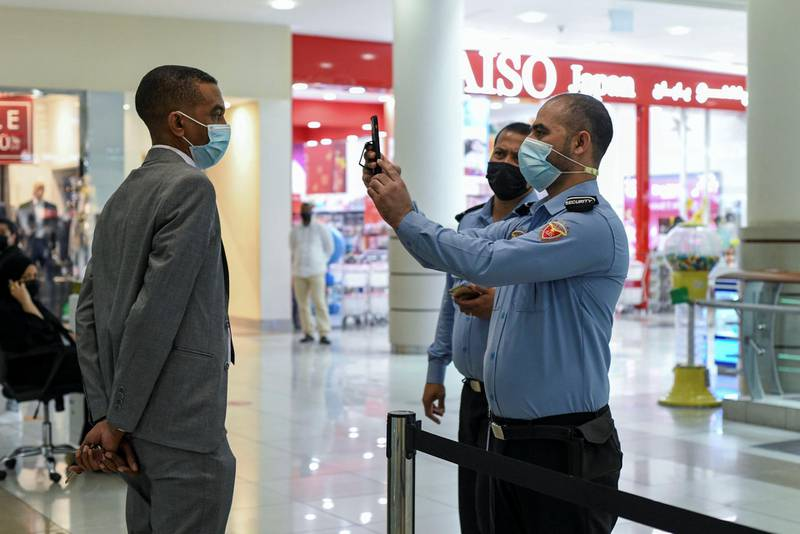 Face Scanning Detection-AD  Two securities have to stand within 5 meters of each other for the EDE scanner and face detection device to sync at Al Wahda Mall in Abu Dhabi on June 28, 2021. Khushnum Bhandari/ The National Reporter: N/A News