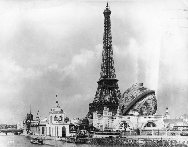 View at the 'Exposition Universelle' across the River Seine towards the Eiffel Tower, and the 'Globe Celeste'. The Eiffel Tower, built to commemorate the 100th anniversary of the French Revolution, was the central focus of both the 1889 and the 1900 Paris Exhibition site.   (Photo by London Stereoscopic Company/Getty Images)