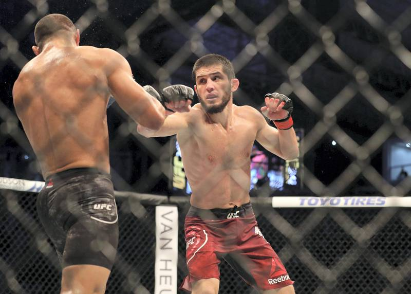 Abu Dhabi, United Arab Emirates - September 07, 2019: Lightweight bout between Davi Ramos and Islam Makhachev (red shorts, winner) in the Main card at UFC 242. Saturday the 7th of September 2019. Yas Island, Abu Dhabi. Chris Whiteoak / The National