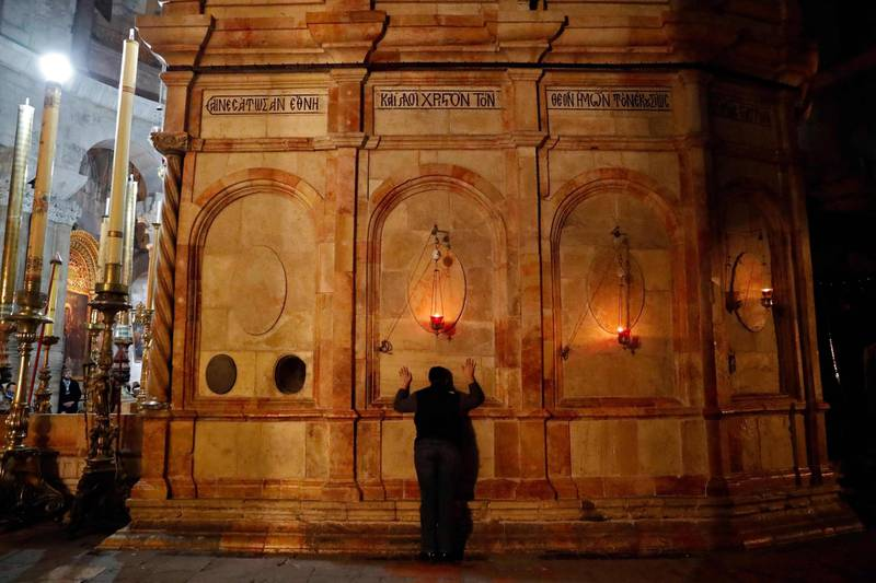 A Christian worshipper prays inside the Church of the Holy Sepulchre in Jerusalem after it reopened on February 28, 2018, following a three-day closure to protest against Israeli tax measures and a proposed law. Jerusalem's Church of the Holy Sepulchre, seen by many as the holiest site in Christianity, reopened on February 28 after a three-day closure to protest against Israeli tax measures and a proposed law. / AFP PHOTO / THOMAS COEX
