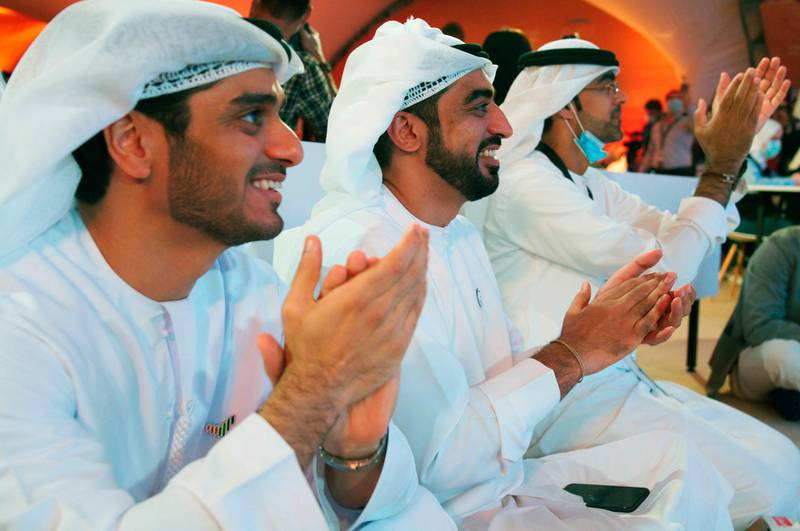 """Emirati men claps as they watch the launch of the """"Amal"""" or """"Hope"""" space probe at the Mohammed bin Rashid Space Center in Dubai, United Arab Emirates, Monday, July 20, 2020. A United Arab Emirates spacecraft, the """"Amal"""" or """"Hope"""" probe, blasted off to Mars from Japan early Monday, starting the Arab world's first interplanetary trip. (AP Photo/Jon Gambrell)"""