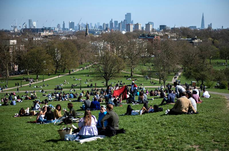 LONDON, ENGLAND - APRIL 04: People socialise in the sunshine on Primrose Hill on April 4, 2021 in London, England. Earlier this week, the UK government eased rules on socialising, permitting groups of six people (or more if limited to two households) to meet outdoors. The latest lockdown measures were imposed at the end of last year to curb a surge in Covid-19 cases. (Photo by Chris J Ratcliffe/Getty Images)