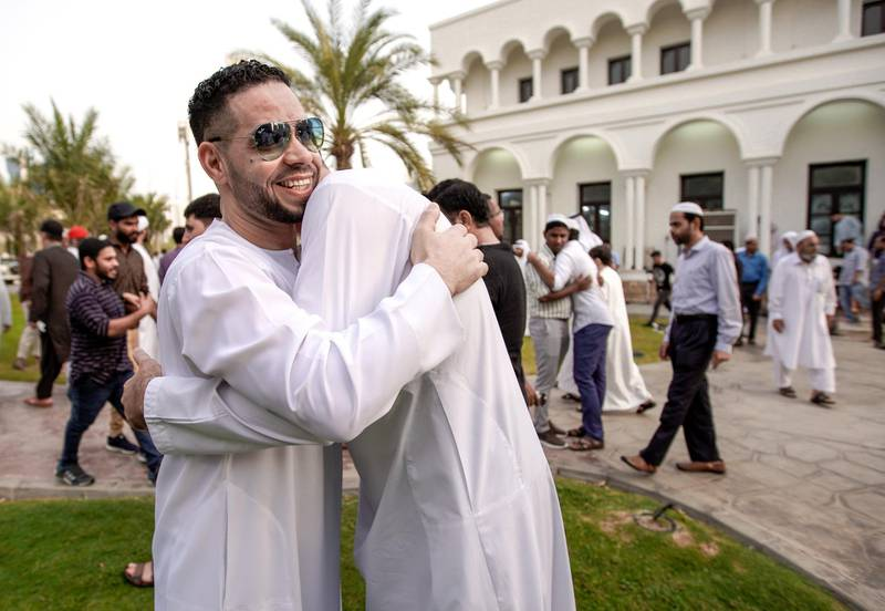 Abu Dhabi, United Arab Emirates, August 11, 2019.  Eid prayers at Zayed The 2nd Mosque.  Friends and relatives great one another after Eid prayers.Victor Besa/The NationalSection:  NAReporter: Haneen Dajani
