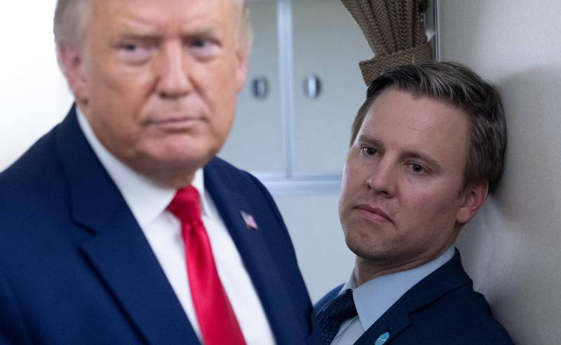 Campaign manager Bill Stepien stands alongside US President Donald Trump as he speaks with reporters aboard Air Force One as he flies from Manchester, New Hampshire to Joint Base Andrews in Maryland, August 28, 2020, following a campaign rally. (Photo by SAUL LOEB / AFP)