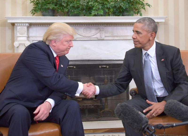 US President Barack Obama shakes hands as he meets with Republican President-elect Donald Trump on transition planning in the Oval Office at the White House on November 10, 2016 in Washington,DC. (Photo by JIM WATSON / AFP)