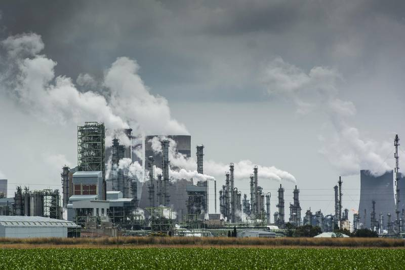 Emissions rise from towers of the Sasol Ltd. Secunda coal-to-liquids plant in Mpumalanga, South Africa, on Monday, Dec. 23, 2019. The level of sulfur dioxide emissions in the Kriel area in Mpumalanga province only lags the Norilsk Nickel metal complex in the Russian town of Norilsk, the environmental group Greenpeace said in a statement, citing 2018 data from NASA satellites. Photographer: Waldo Swiegers/Bloomberg