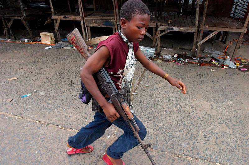 epa03197285 (FILE) A file photograph dated 30 July 2003 showing a Liberian child soldier fighting for Charles Taylor's government forces during the civil war in Monrovia, Liberia. Media reports state that Charles Taylor on 26 April 2012 became the first former African head of state to be convicted by a UN court after he was found guilty in The Hague, Netherlands,  of 11 charges of war crimes and crimes against humanity committed in Sierra Leone, including terror, murder, rape, and conscripting child soldiers. While the court found it could not prove that Taylor did have direct command over rebel operations, presiding judge Richard Lussick said the court had 'found unanimously that Mr Taylor aided and abetted RUF and AFRC rebels in the commission of war crimes and crimes against humanity in Sierra Leone.' The crimes for which he was prosecuted date from November 1996 until the official end of the war, in January 2002.  EPA/NIC BOTHMA *** Local Caption *** 50315640
