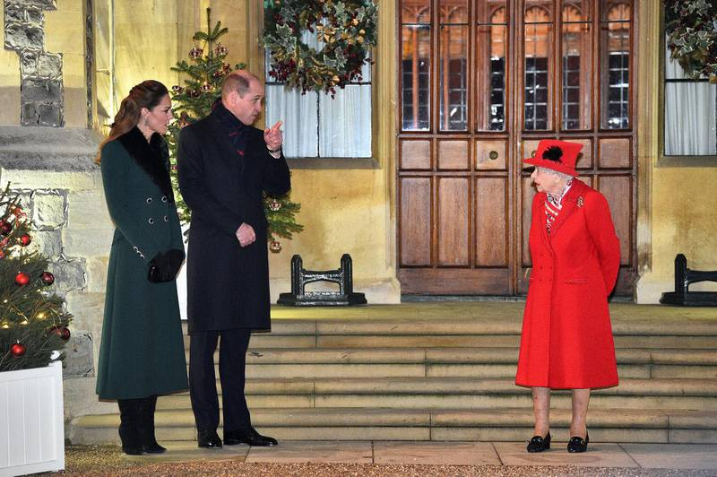 WINDSOR, ENGLAND - DECEMBER 08: Queen Elizabeth II (R) talks with Prince William, Duke of Cambridge, (2L) and Catherine, Duchess of Cambridge, as they wait to thank local volunteers and key workers for the work they are doing during the coronavirus pandemic and over Christmas in the quadrangle of Windsor Castle on December 8, 2020 in Windsor, England.  The Queen and members of the royal family gave thanks to local volunteers and key workers for their work in helping others during the coronavirus pandemic and over Christmas at Windsor Castle in what was also the final stop for the Duke and Duchess of Cambridge on their tour of England, Wales and Scotland. (Photo by Glyn Kirk - WPA Pool/Getty Images)