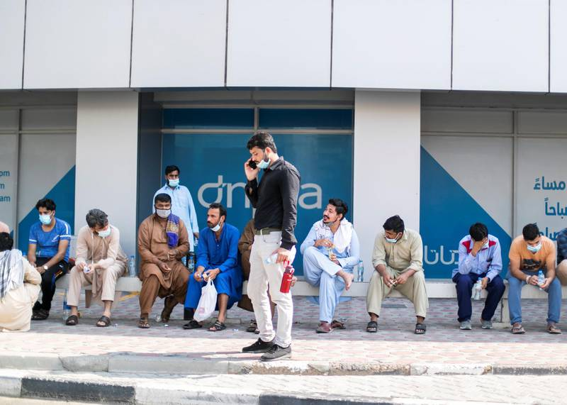 DUBAI, UNITED ARAB EMIRATES. 21 June 2020. Almost 150 Pakistani citizens line up today outside Dnata to get flight tickets to Pakistan. The doors did not open at their usual time, 9am. At 9:45am they were all asked to leave, and told that they can longer get tickets from here.(Photo: Reem Mohammed/The National)Reporter: SARWATSection: