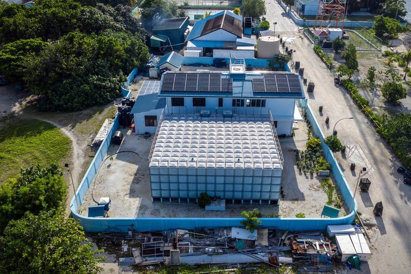 MAHIBADOO, MALDIVES - DECEMBER 17: A water desalination plant is pictured on December 17, 2019 in Mahibadoo, Maldives. The Maldives is the worlds lowest lying country with a highest natural point of just 2.4 meters above sea level. As well as an increasing population, the nation faces a number of problems caused by climate change including rising sea levels, unpredictable weather, a shortage of drinking water, coastal erosion and declining fish stocks. With no rivers or streams on any of the islands, Maldivians have traditionally lived from fishing and except for Male and a handful of other islands, most islands rely on rain for drinking water and, increasingly, bottled water brought in from other islands. (Photo by Carl Court/Getty Images)