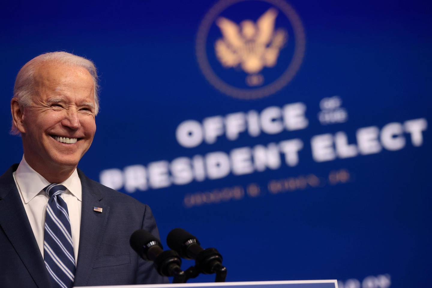 U.S. President-elect Joe Biden smiles as he speaks about health care and the Affordable Care Act (Obamacare) at the theater serving as his transition headquarters in Wilmington, Delaware, U.S., November 10, 2020. REUTERS/Jonathan Ernst