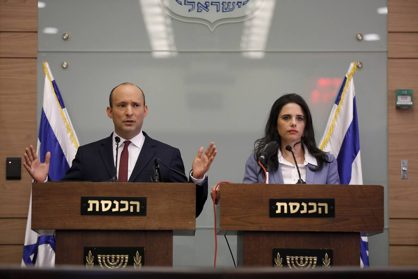 epa07176691 Israeli Minister of Education Naftali Bennett (L) and Justice Minister Ayelet Shaked speak during a press conference in the Israeli Knesset, (Israeli Parliament), in Jerusalem, 19 November 2018. Media reports state that the Netanyahu government will not go to early elections after Naftali Bennett and Ayelet Shaked of the Jewish Home Party decided not to resign from the coalition. The elections are scheduled to take place in November 2019  EPA/ABIR SULTAN