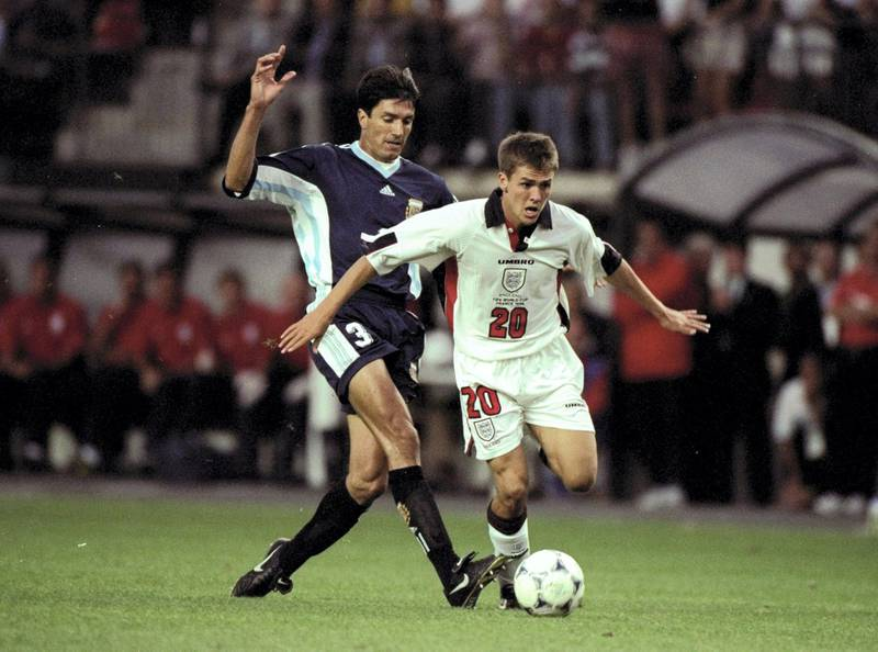 30 Jun 1998:  Michael Owen of England in action against Jose Chamet of Argentina during the 1998 World Cup match against Argentina played in St Etienne, France.  The match finished in a 2-2 draw after extra-time and in a dramatic twist England once againlost in the penalty shoot-out 4-3. \ Mandatory Credit: Ross Kinnaird /Allsport