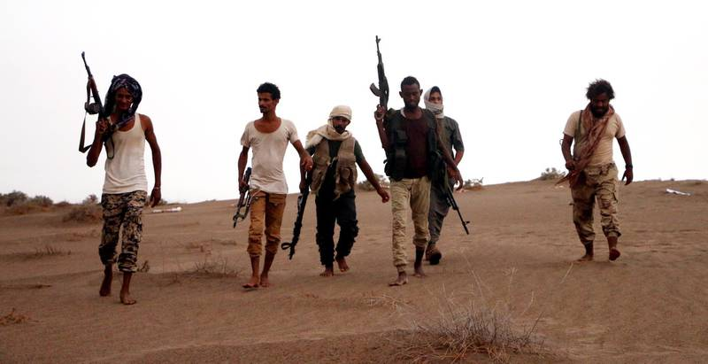 epaselect epa06908532 Soldiers of Yemeni government army backed by the Saudi-led coalition take position during military operations on Houthi positions in the port province of Hodeidah, Yemen, 24 July 2018.  According to reports, Yemeni government forces backed by the Saudi-led coalition claimed control of strategic towns in the Red Sea port-province of Hodeidah after fierce clashes broke out with the Houthi militias.  EPA/NAJEEB ALMAHBOOBI