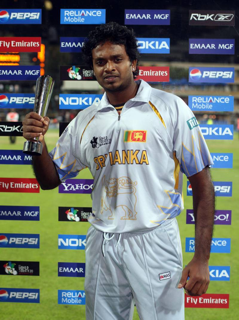 JOHANNESBURG, SOUTH AFRICA - SEPTEMBER 18:  Dilhara Fernando of Sri Lanka with the man of the match award after his team beat Bangladesh at The Wanderers Cricket Ground during The ICC World Twenty20 Championship on September 18, 2007 in Johannesburg, South Africa. (Photo by Julian Herbert/Getty Images)