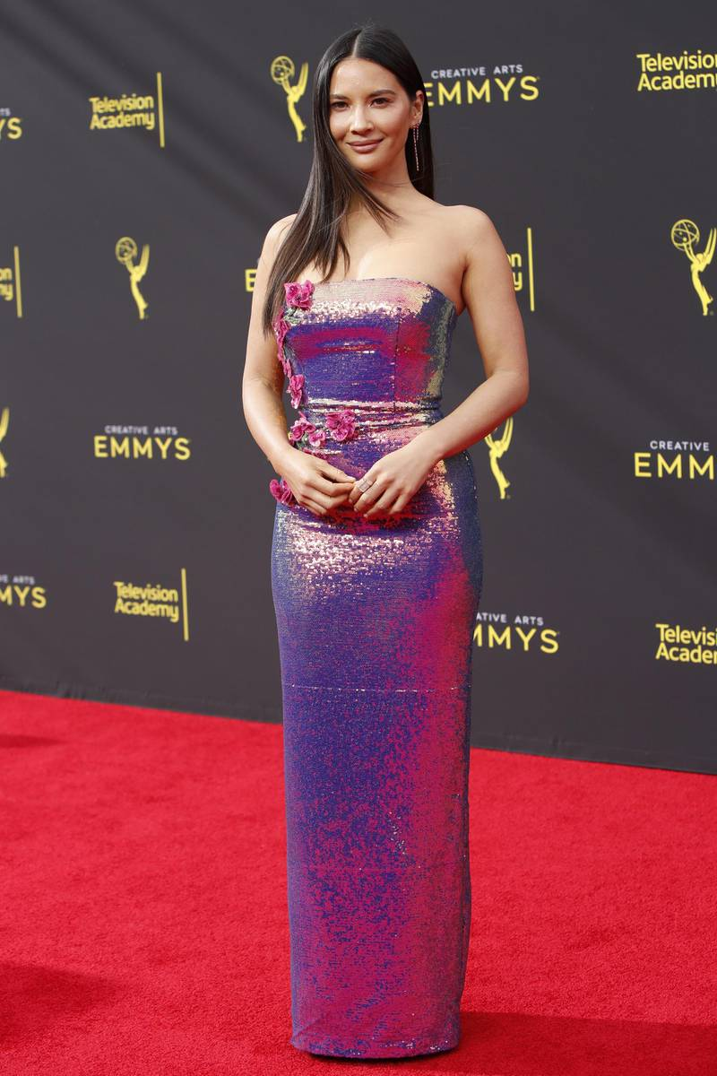 epa07845832 US actress Olivia Munn arrives for the 2019 Creative Arts Emmy Awards at the Microsoft Theater in Los Angeles, California, USA, 15 September 2019. The Creative Arts Emmy Awards honor excellence in Television technical categories such as makeup, casting direction, costume design, editing and cinematography. The 71st Primetime Emmy Awards Ceremony will take place on 22 September 2019.  EPA-EFE/NINA PROMMER