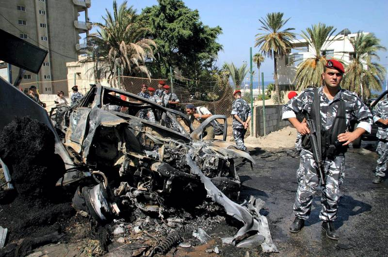 Lebanese policemen gather at the site where outgoing Economy and Trade Minister Marwan Hamadeh's car was targeted by a bomb in Beirut 01 October 2004. Hamadeh, who resigned recently in a dispute over Syria's domination of the country, was wounded and his driver killed in the blast, which occurred on the Mediterranean seafront of the Lebanese capital, a source at the American University of Beirut hospital said.  AFP PHOTO/- (Photo by AFP)