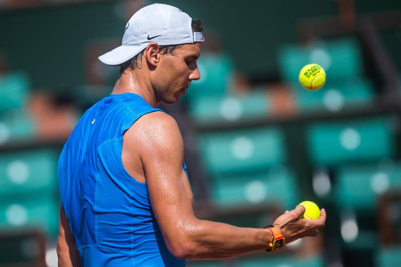 epa06761956 Rafael Nadal of Spain during a training session on a court at Roland Garros in Paris, France, 25 May 2018. The 117th French Open tennis tournament starts with its first round matches on 27 May 2017.  EPA/CHRISTOPHE PETIT TESSON