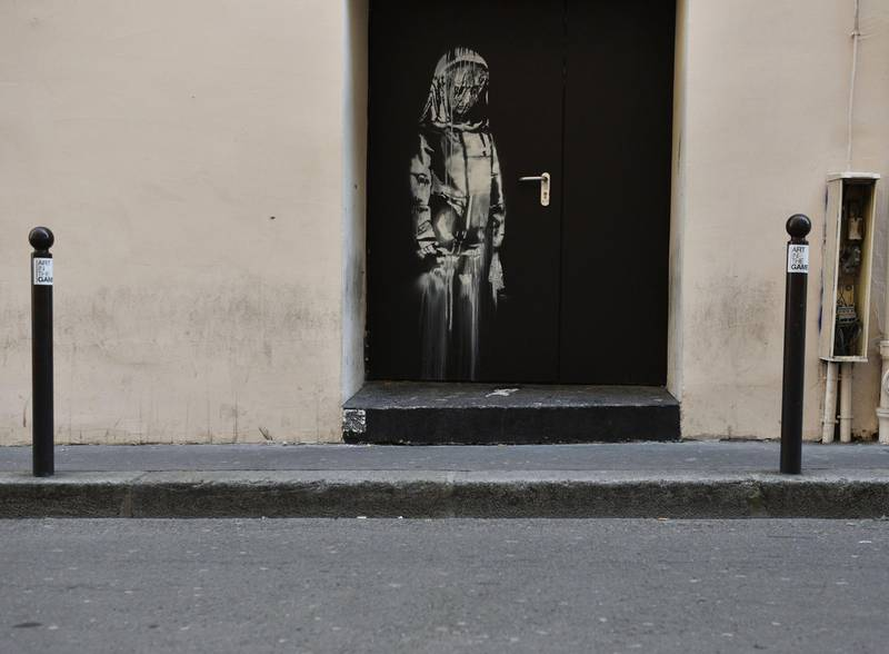epa07322898 (FILE) A recent artwork believed to be attributed to Banksy is of a woman veiled in mourning next to the Bataclan concert venue in Paris, France, 26 June 2018 (reissued 26 January 2019). According to reports on 26 January, Banksy's mural located on the door to Bataclan concert hall, where 90 people have been killed in a terror attack in 2015, has been stolen.  EPA/JULIEN DE ROSA
